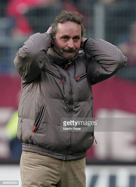 Peter Neururer headcoach of Hannover looks dejected after losing the Bundesliga match between Hanover 96 and FC Schalke 04 at the AWD Arena on March...