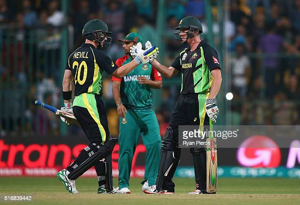 Peter Nevill and James Faulkner of Australia celebrate after Faulkner hit the winning runs during the ICC World Twenty20 India 2016 Super 10s Group 2...