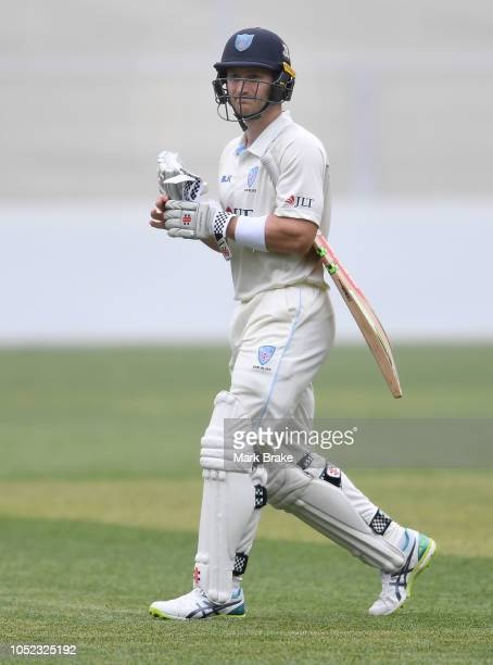 Peter Nevill captain of the Blues after being bowled by Joe Mennie of the Redbacks during the Sheffield Shield match between South Australia and New...