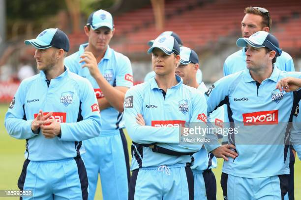 Peter Nevill, Josh Hazellwood, Steve Smith, David Warner and Ben Rohrer of the Blues look dejected after defeat during the Ryobi Cup Final match...