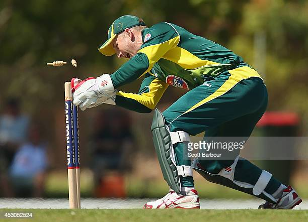 Peter Nevill of Australia 'A' runs out Manan Vohra of India 'A' during the Cricket Australia Quadrangular Series Final match between Australia 'A'...