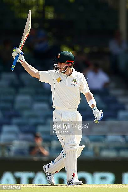 Peter Nevill of Australia celebrates his half century during day five of the First Test match between Australia and South Africa at the WACA on...