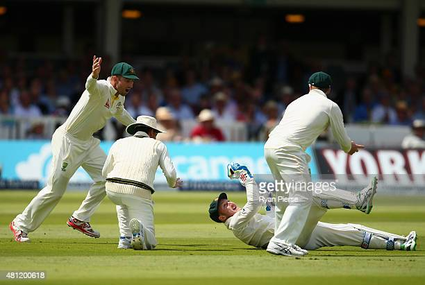 Peter Nevill of Australia dives to catch Jos Buttler of England which which was ruled not out during day three of the 2nd Investec Ashes Test match...