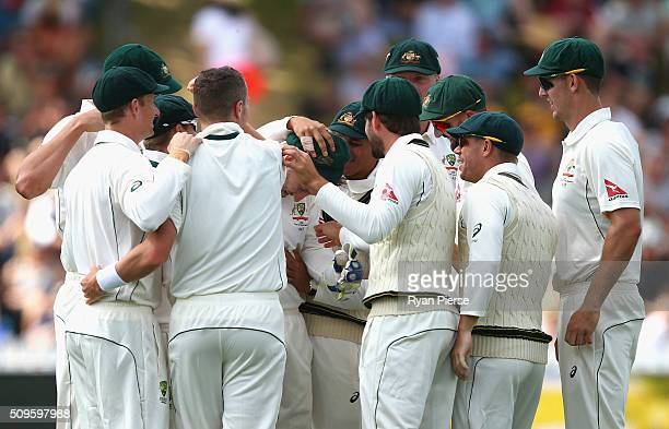 Peter Nevill of Australia is congratulated by his team after taking a catch to dismiss Kane Williamson of New Zealand off the bowling of Peter Siddle...