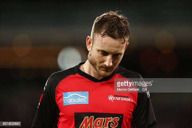 Peter Nevill of the Melbourne Renegades comes from the field with an injury to his right jaw after he was hit by the bat of Brad Hodge of the...