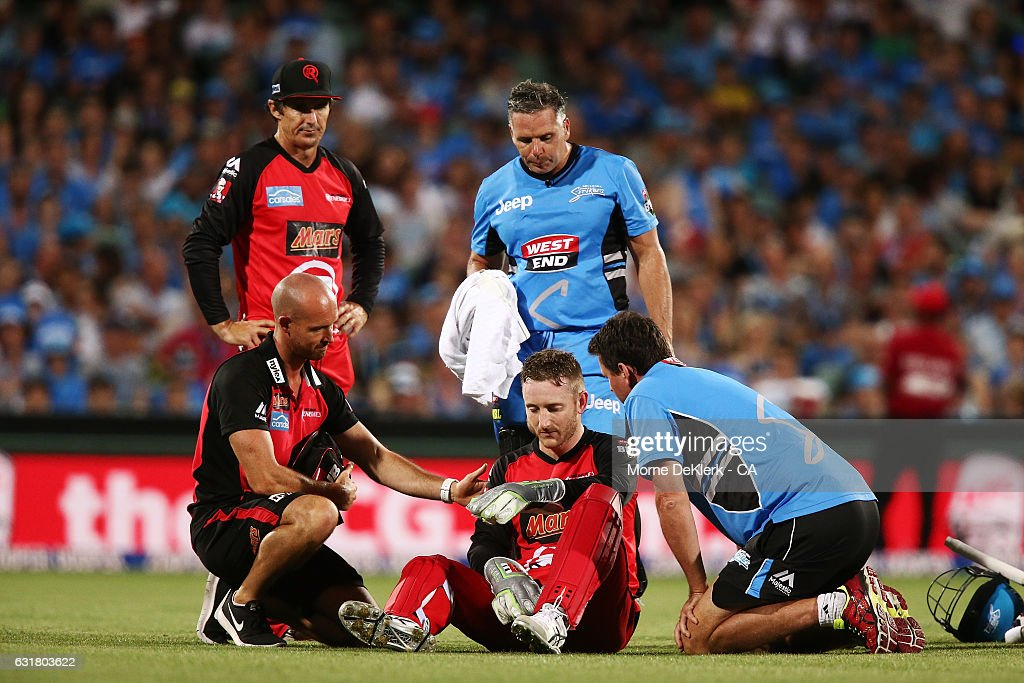 Peter Nevill of the Melbourne Renegades is helped by medical staff and players after he was hit by the bat of Brad Hodge of the Adelaide Strikers during the Big Bash League match between the Adelaide Strikers and the Melbourne Renegades at Adelaide Oval on January 16, 2017 in Adelaide, Australia.