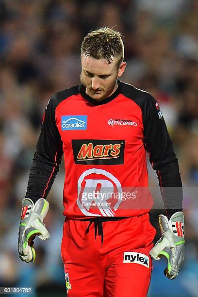 Peter Nevill of the Melbourne Renegades walks from the field after being struck in the head by the bat of Brad Hodge of the Adelaide Strikers during...