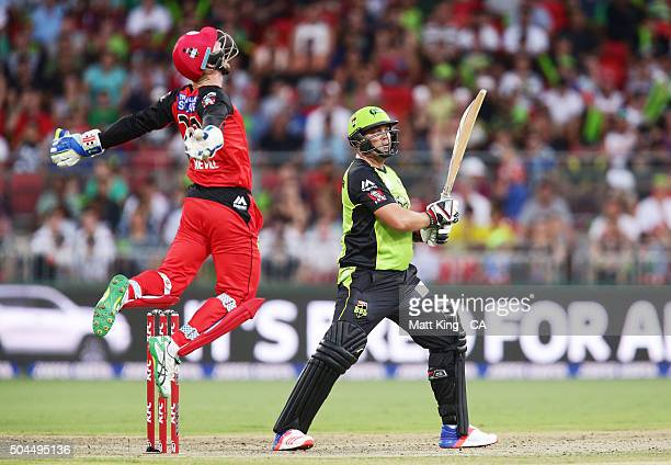 Peter Nevill of the Renegades celebrates after taking a catch to dismiss Jacques Kallis of the Thunder during the Big Bash League match between the...