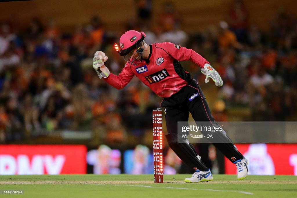 Peter Nevill of the Sixers celebrates after taking the wicket of Hilton Cartwright of the Scorchers during the Big Bash League match between the Perth Scorchers and the Sydney Sixers at WACA on January 1, 2018 in Perth, Australia.