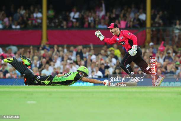 Peter Nevill of the Sixers celebrates running out Chris Green of the Thunder during the Big Bash League match between the Sydney Sixers and the...