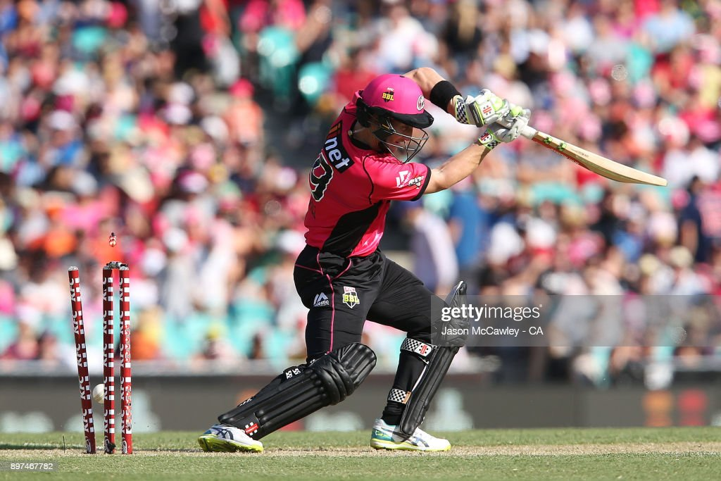 Peter Nevill of the Sixers is bowled by Mitchell Johnson of the Scorchers during the Big Bash League match between the Sydney Sixers and the Perth Scorcher at Sydney Cricket Ground on December 23, 2017 in Sydney, Australia.