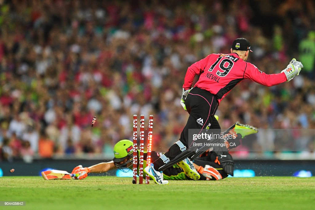 Peter Nevill of the Sixers runs out Chris Green of the Thunder during the Big Bash League match between the Sydney Sixers and the Sydney Thunder at Sydney Cricket Ground on January 13, 2018 in Sydney, Australia.