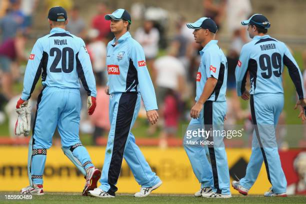 Peter Nevill, Steve Smith, David Warner and Ben Rohrer of the Blues look dejected after defeat during the Ryobi Cup Final match between the...
