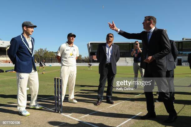 Peter Neville Captain of the New South Wales Blues and Aaron Finch Captain of the Victorian Bushrangers watch as Victorian Premier Daniel Andrews...