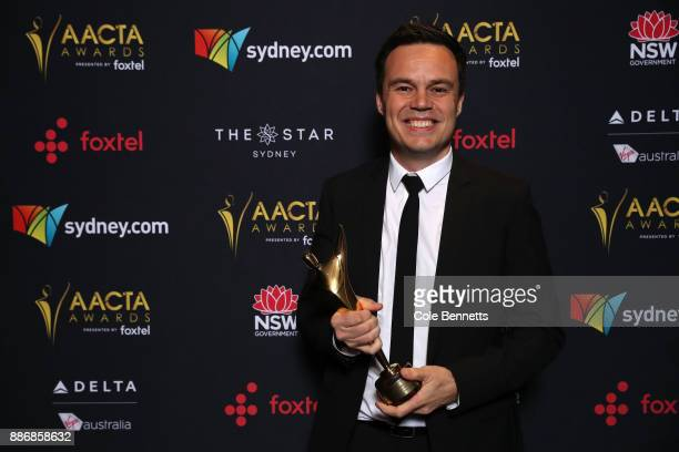 Peter Newman poses with an AACTA Award for Best Light Entertainment Television Series during the 7th AACTA Awards Presented by Foxtel | Ceremony at...