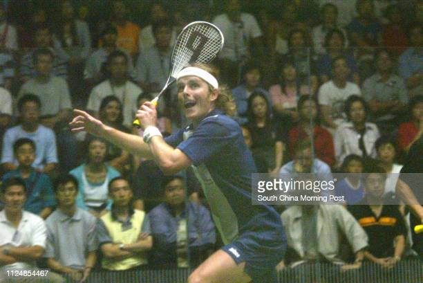 Peter Nichol of England plays a shot on his way to victory over Wong Waihang of Hong kong in the Cathay Pacific Squash open first match at the HK...