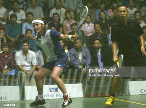 Peter Nichol of England plays a shot on his way to win over Wong Waihang of Hong kong in the Cathay Pacific Squash open first match at the HK Squash...
