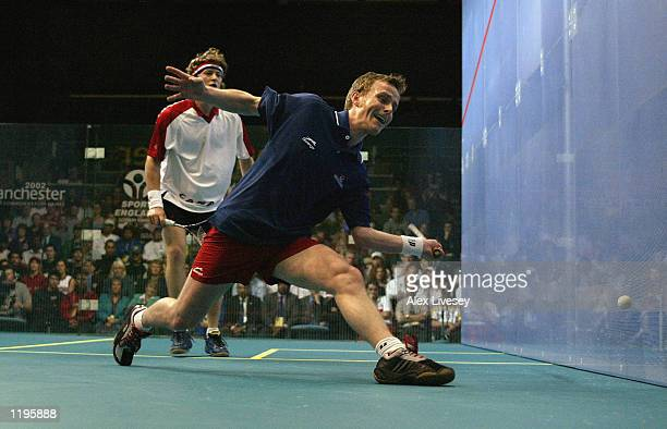 Peter Nicol of England plays a forehand against Jonathon Power of Canada during the Men's Singles Final at the National Squash Centre Manchester...