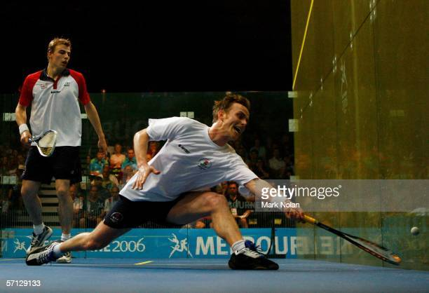 Peter Nicol of England stretches to play a shot in his men's singles semifinal squash match against Nick Matthew of England at the Melbourne Sports...