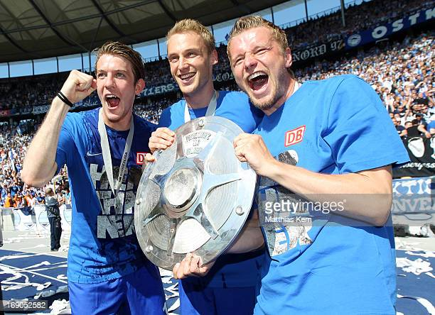 Peter Niemeyer Felix Bastians and Maik Franz of Berlin pose with the cup after winning the championship after the Second Bundesliga match between...