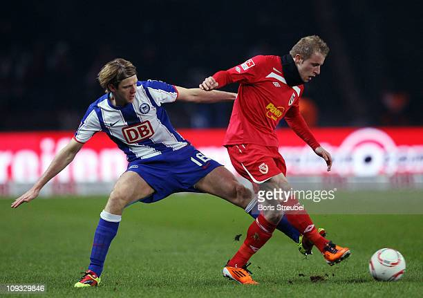 Peter Niemeyer of Berlin battles for the ball with Daniel Adlung of Cottbus during the Second Bundesliga match between Hertha BSC Berlin and FC...