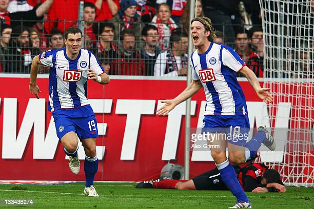 Peter Niemeyer of Berlin celebrates his team's second goal with team mate PierreMichel Lasogga during the Bundesliga match between SC Freiburg and...
