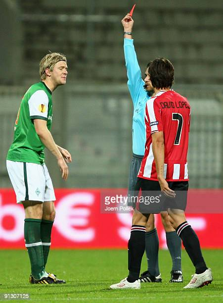 Peter Niemeyer of Bremen gets the yellowred card from referee Alexandru Dan Tudor during the UEFA Europa League Group L match between SV Werder...