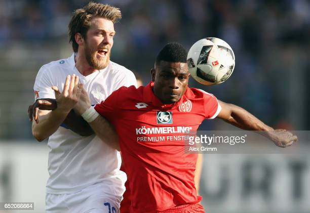 Peter Niemeyer of Darmstadt is challenged by Jhon Cordoba of Mainz during the Bundesliga match between SV Darmstadt 98 and 1 FSV Mainz 05 at...