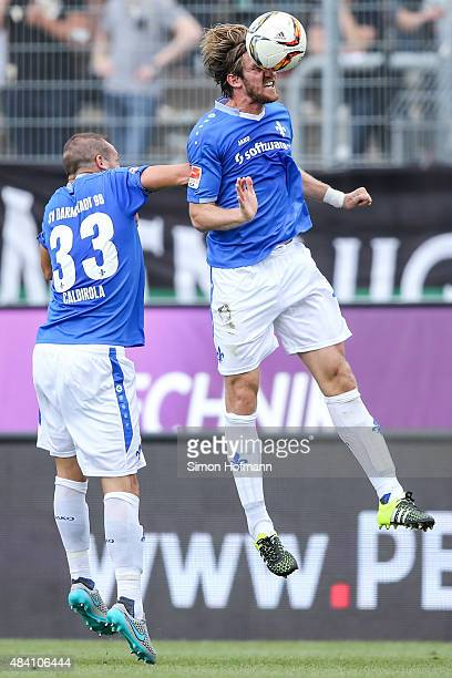 Peter Niemeyer of Darmstadt jumps for a header with his team mate Luca Caldirola during the Bundesliga match between SV Darmstadt 98 and Hannover 96...