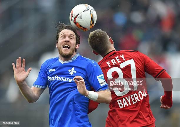 Peter Niemeyer of Darmstadt jumps for a header with Marlon Frey of Leverkusen during the match between SV Darmstadt 98 and Bayer Leverkusen at...