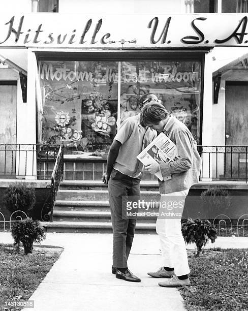 Peter Noone lead singer of Herman's Hermits chats with Stevie Wonder outside the offices of Motown Records in 1966 in Detroit Michigan