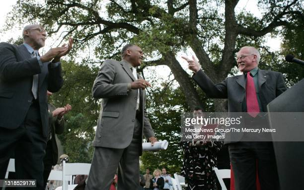 Peter Norman, Olympic medalist and activist, right, gives tribute to John Carlos, left, and Tommie Smith, both San Jose State University alumni,...