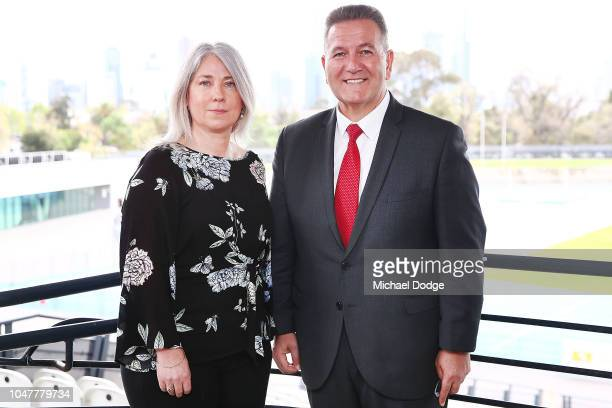 Peter Norman's daughter Janita Norman and Minister For Sport John Eren MP pose during a media opportunity announcing the installation of a statue in...