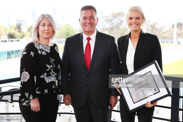 Peter Norman's daughter Janita Norman Minister For Sport John Eren MP and Peter Norman Humanitarian Award winner Eloise Wellings pose during a media...