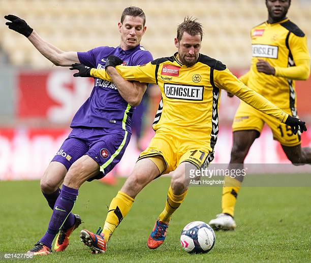 Peter Nymann of AC Horsens and Jonas Borring of FC Midtjylland compete for the ball during the Danish Alka Superliga match between AC Horsens and FC...