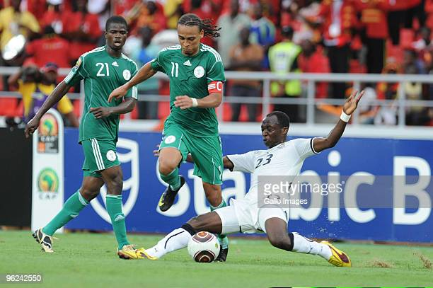 Peter Odemwingie of Nigeria and Haminu Dramani of Ghana compete during go for the ball during the Africa Cup of Nations semi final match between...