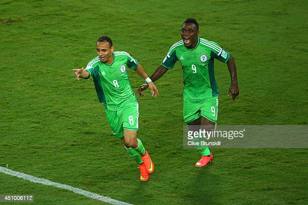 Peter Odemwingie of Nigeria celebrates scoring his team's first goal with teammate Emmanuel Emenike during the 2014 FIFA World Cup Group F match...