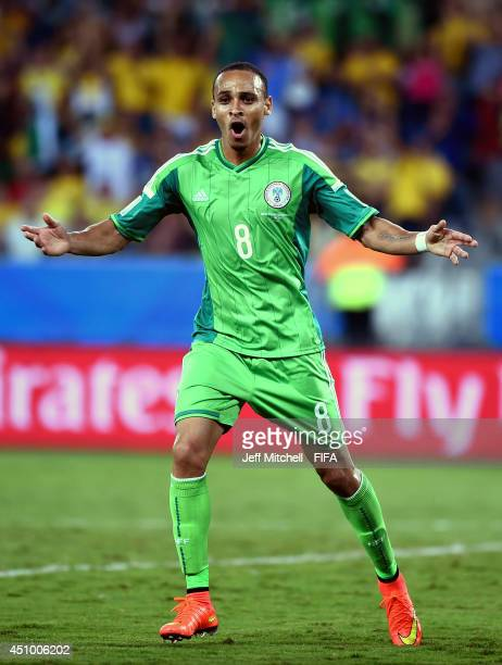 Peter Odemwingie of Nigeria celebrates scoring his team's first goal during the 2014 FIFA World Cup Brazil Group F match between Nigeria and...