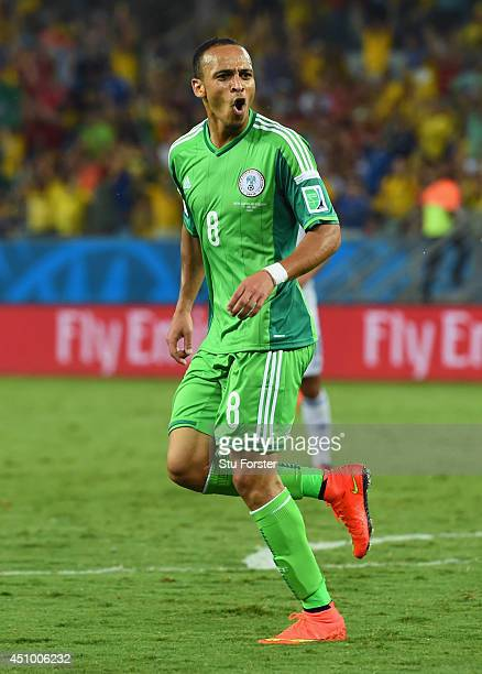 Peter Odemwingie of Nigeria celebrates scoring his team's first goal during the 2014 FIFA World Cup Group F match between Nigeria and...