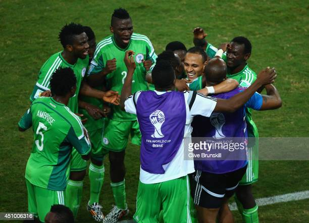 Peter Odemwingie of Nigeria celebrates scoring his team's first goal with teammates during the 2014 FIFA World Cup Group F match between Nigeria and...