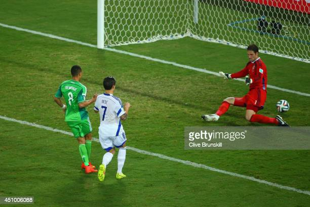 Peter Odemwingie of Nigeria scores his team's first goal past Asmir Begovic of Bosnia and Herzegovina during the 2014 FIFA World Cup Group F match...