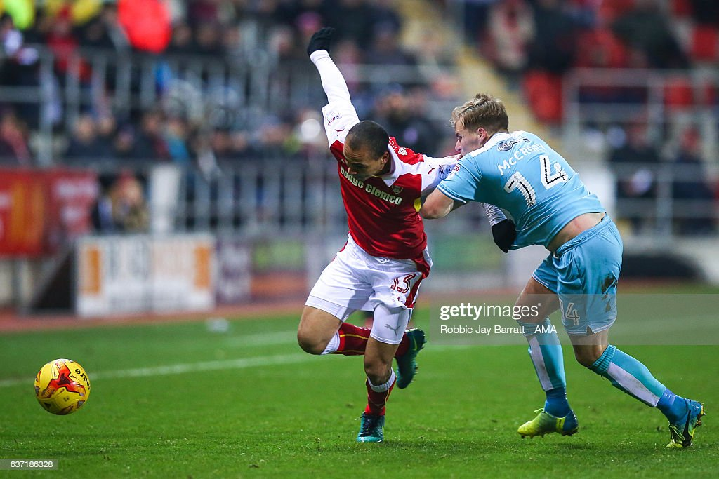 Peter Odemwingie of Rotherham United and Damien McCrory of Burton Albion during the Sky Bet Championship match between Rotherham United and Burton Albion at The New York Stadium on December 29, 2016 in Rotherham, England.