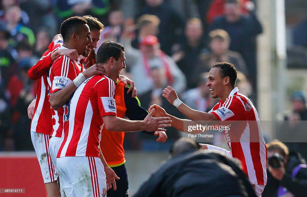 Peter Odemwingie (R) of Stoke City celebrates his goal with team mates during the Barclays Premier League match between Stoke City and Hull City at Britannia Stadium on March 29, 2014 in Stoke on Trent, England.