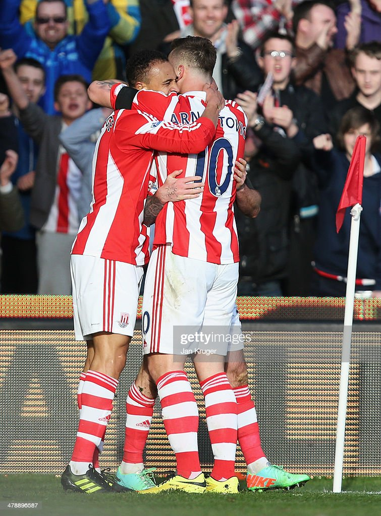 Peter Odemwingie of Stoke City (L) celebrates with Marko Arnautovic (R) as he scores their third goal during the Barclays Premier League match between Stoke City and West Ham United at Britannia Stadium on March 15, 2014 in Stoke on Trent, England.