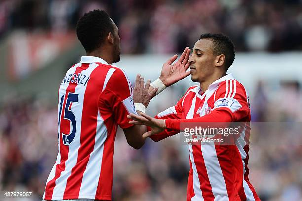 Peter Odemwingie of Stoke City celebrates with team mate Steven N'Zonzi after scoring during the Barclays Premier League match between Stoke City and...