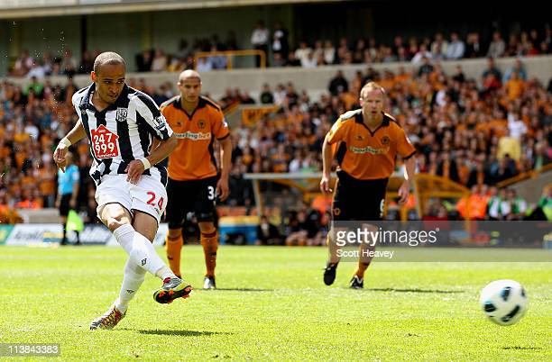 Peter Odemwingie of WBA scores their first goal from the penalty spot during the Barclays Premier League match between Wolverhampton Wanderers and...