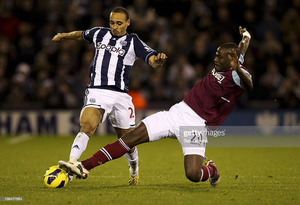 Peter Odemwingie of West Brom is tackled by Guy Demel of West Ham during the Barclays Premier League match between West Bromwich Albion and West Ham United at the Hawthorns on December 16, 2012 in West Bromwich, England.