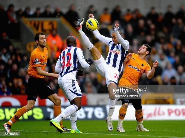 Peter Odemwingie of West Bromwich Albion clears from Matt Jarvis of Wolverhampton Wanderers during the Barclays Premier League match between...