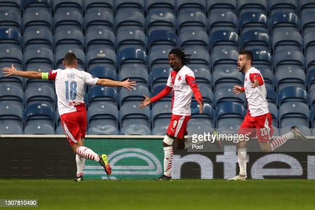 Peter Olayinka of Slavia Praha celebrates with Jan Boril and Jakub Hromada after scoring their side's first goal during the UEFA Europa League Round...