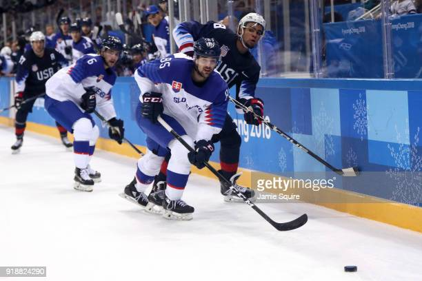 Peter Olvecky of Slovakia handles the puck against Jordan Greenway of the United States during the Men's Ice Hockey Preliminary Round Group B game at...